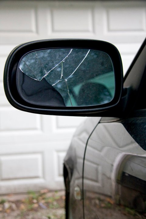 Broken Mirror. It's a good thing his mirrors fold back, otherwise it would have been toast.