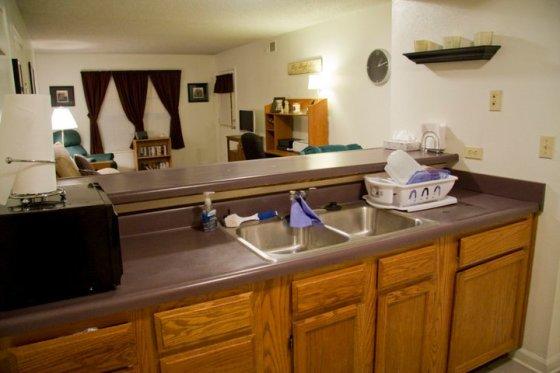 Kitchen, breakfast bar, and livingroom