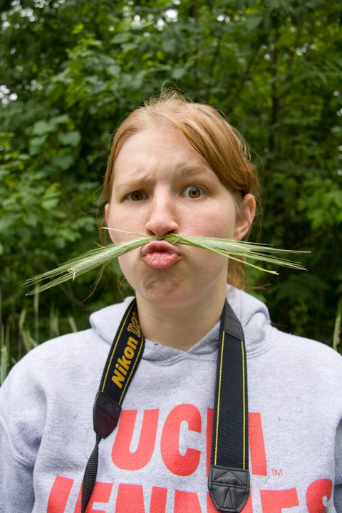 Char with her grass mustache. Afterwords we discovered that they made our faces super itchy.