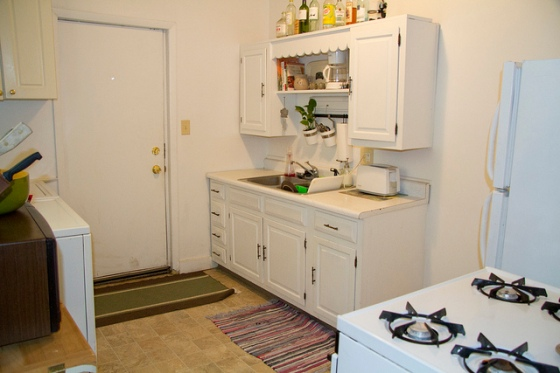 The kitchen. The white thing on the left side of the photo is the washer and dryer
